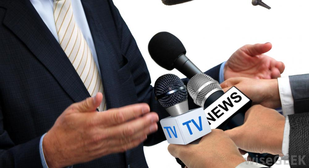 man-conducting-interview-with-press