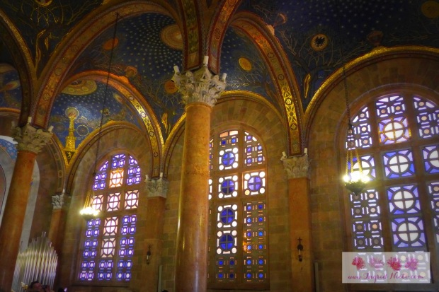 The ceiling was intentionally painted a dark blue hue like the sky at night while natural light streams through the beautiful coloured glass.